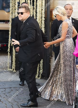 British television host and comedian James Corden (L) and wife Julia Carey arrive for the wedding ceremony of fashion designer Misha Nonoo and businessman Michael Hess at Villa Aurelia in Rome, Italy, 20 September 2019.