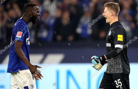 Schalke's Salif Sane and Schalke's goalkeeper Alexander Nuebel celebrates after winning the German Bundesliga soccer match between FC Schalke 04 and FSV Mainz 05 in Gelsenkirchen, Germany, 20 September 2019.