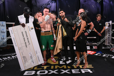 Steven Donnelly (green shorts) defeats Lenny Fuller and is presented with the golden robe by Amir Khan at Indigo at the O2 London on 20th September 2019