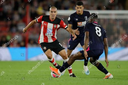 Southampton's Oriol Romeu, left, is challenged by Bournemouth's Jefferson Lerma during the English Premier League soccer match between Southampton and Bournemouth at St Mary's stadium in Southampton, England
