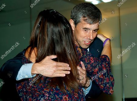 Beto o'rourke, r m. U.S. Rep. Beto O'Rourke, D-Texas, right, hugs Heather Dearman during a roundtable discussion about the issues of gun control and the need for additional mental health measures with survivors of mass shooting victims at an office, in downtown Denver
