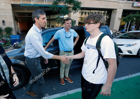 R m. U.S. Rep. Beto O'Rourke, D-Texas, left, greets one of the participants in a global climate change march, through downtown Denver. The world over, both young and old have banded together to demand action from leaders to combat climate change