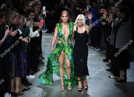 Italian designer Donatella Versace (R) and US actress Jennifer Lopez on the catwalk at the end of the Versace show during the Milan Fashion Week, in Milan, Italy, 20 September 2019. Spring-Summer 2020 women's collections are presented at the Milano Moda Donna from 17 to 23 September.