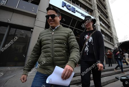 Swedish computer scientist Ola Bini (R) and his lawyer Catlos Soria leave the Prosecutor Office, in Quito, Ecuador, 20 September 2019. Bini, a friend of Julian Assange and accused of meddling in computer systems in Ecuador, alleged that he did 'exactly the same' as the firm that discovered the leaking of the data of millions of Ecuadorians, and reproached that he is now prosecuted for it.