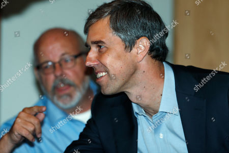 Stock Picture of R m. U.S. Rep. Beto O'Rourke, D-Texas, greets participants during a roundtable discussion about the issues of gun control and the need for additional mental health measures with survivors of mass shooting victims at an office, in downtown Denver. Colorado State Rep. Tom Sullivan, D-Aurora, back, looks on