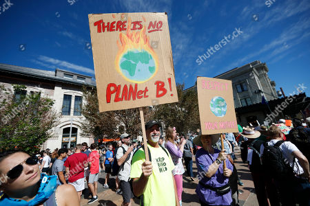 Bill, rose ann walker, r m. Bill Walker, left, of Denver, joins his sister, Rose Ann Walker of Gainesville, Fla., in waving placards during a global climate change march, through downtown Denver. The world over, both young and old have banded together to demand action from leaders to combat climate change
