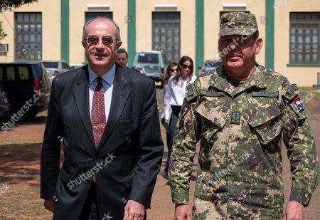 The ambassador of Spain in Paraguay Javier Hernandez (L) and the director of the OMP of the Armed Forces of Paraguay Colonel Claudio Roman Alvarenga at the Joint Training Center for Peace Operations (Cecopaz) after finishing his visit, outside Asunción, Paraguay, 20 September 2019.  Paraguay seeks to participate with Spain in peacekeeping operations, thanks to a memorandum of understanding signed in January 2017, as representatives of both countries advanced on Friday during a visit to the Joint Peace Operations Training Center (Cecopaz).