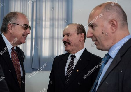 The ambassador of Spain in Paraguay Javier Hernandez (L) speaks with the Minister of Defense of Paraguay, General Bernardino Soto Estigarribia (C) and the head of a delegation of the European Union Paolo Berizzi during a visit to the Joint Training Center for Peace Operations (Cecopaz) after finishing his visit, outside Asunción, Paraguay, 20 September 2019. Paraguay seeks to participate with Spain in peacekeeping operations, thanks to a memorandum of understanding signed in January 2017, as representatives of both countries advanced on Friday during a visit to the Joint Peace Operations Training Center (Cecopaz).