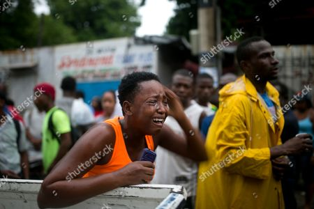 A relatives of Rigueur Pierre Richard, who was killed in a drive-by shooting two blocks from the national palace, is overcome with grief, during a protest against fuel shortages and demanding the resignation of President Jovenel Moise in Port-au-Prince, Haiti, . According to witnesses, two other people were injured in the attack. Haiti remains at a standstill with no public transportation available and banks, government offices, and schools closed amid street protests due to an ongoing fuel crisis