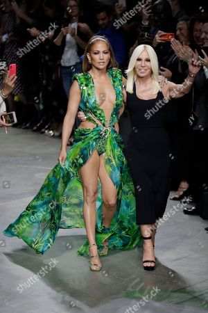 Jennifer Lopez, Donatella Versace. Actress Jennifer Lopez, left, and designer Donatella Versace accept applause at the conclusion of the Versace Spring-Summer 2020 collection, unveiled during the fashion week, in Milan, Italy