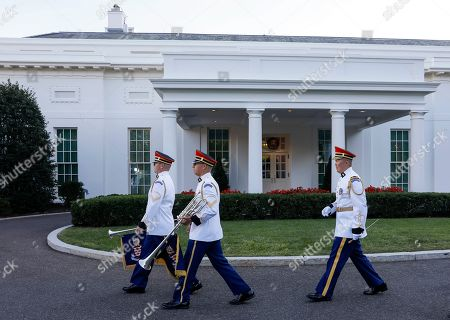 Members of a US military band walk past the West Wing before US President Donald J. Trump and First Lady Melania Trump host Prime Minister of Australia Scott Morrison and his wife, Jenny Morrison, for a state dinner at the White House in Washington, DC, USA, 20 September 2019. The occasion marks the second state visit of Donald Trump's presidency.