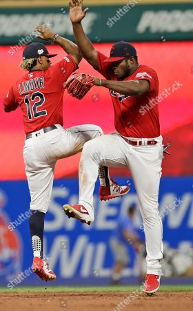 Yasiel Puig, Francisco Lindor. Cleveland Indians' Francisco Lindor, left, and Yasiel Puig celebrate after the Indians defeated the Philadelphia Phillies 5-2 in a baseball game, in Cleveland