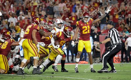 Southern California cornerback Greg Johnson (9) picks up a Utah fumble during the first half of an NCAA college football game, in Los Angeles