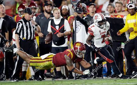 Devonta'e Henry-Cole, Palaie Gaoteote IV. Utah running back Devonta'e Henry-Cole (7) runs past Southern California linebacker Palaie Gaoteote IV (1) during the second half of an NCAA college football game, in Los Angeles