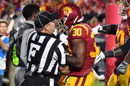 Los Angeles, CA.USC Trojans running back Markese Stepp #30 celebrates running in for the touchdown trying to get to USC Alumni Reggie Bush on the end line as the field judge holds him back in action during the fourth quarter of the NCAA Football game between the USC Trojans and the Utah Utes at the Coliseum in Los Angeles, California..The USC Trojans defeat the Utah Utes 30-23..Mandatory Photo Credit : Louis Lopez/CSM