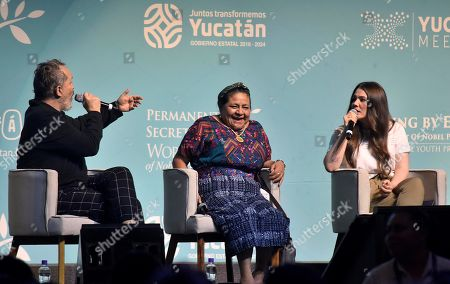 Guatemalan activist Nobel Peace Prize laureate (1992) Rigoberta Menchu (C), Spanish singer Miguel Bose (L), and Mexican singer Joy Huerta (R), converse during the 'Celebrating Our Differences' forum, during the XVII World Summit of the Nobel Peace Prize Laureates, in Merida, Yucatan state, Mexico, 20 September 2019.