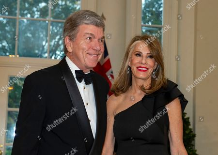 Stock Photo of United States Senator Roy Blunt (L, Republican of Missouri) and Abigail Blunt (R) arrive for the State Dinner hosted by United States President Donald J. Trump and First lady Melania Trump in honor of Prime Minister Scott Morrison of Australia and his wife, Jenny Morrison, at the White House in Washington, DC, USA, 20 September 2019.