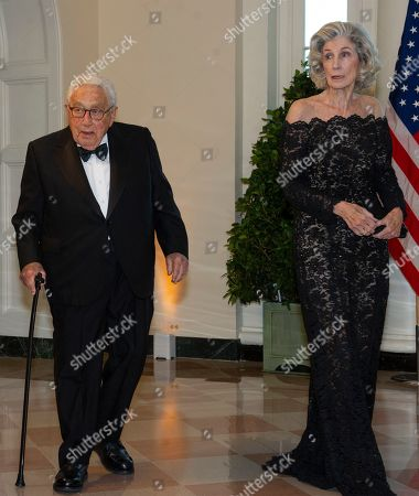 Stock Picture of Former United States Secretary of State Henry Kissinger (L) and Nancy Kissinger (R) arrive for the State Dinner hosted by United States President Donald J. Trump and First lady Melania Trump in honor of Prime Minister Scott Morrison of Australia and his wife, Jenny Morrison, at the White House in Washington, DC, USA, 20 September 2019.