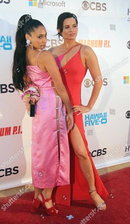 Meaghan Rath and Katrina Law have fun on the red carpet during the Hawaii Five-O and Magnum P.I. Sunset On The Beach event on Waikiki Beach in Honolulu, Hawaii - Michael Sullivan/CSM