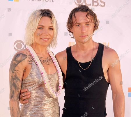 Stock Image of Skylar Grey and fiance Elliot Taylor during the Hawaii Five-O and Magnum P.I. Sunset On The Beach event on Waikiki Beach in Honolulu, Hawaii - Michael Sullivan/CSM