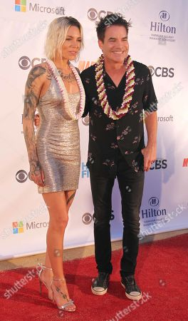 Stock Picture of Skylar Grey and Rob Morrow during the Hawaii Five-O and Magnum P.I. Sunset On The Beach event on Waikiki Beach in Honolulu, Hawaii - Michael Sullivan/CSM