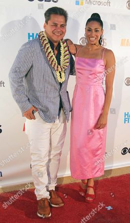 Peter M. Lenkov and Meaghan Rath during the Hawaii Five-O and Magnum P.I. Sunset On The Beach event on Waikiki Beach in Honolulu, Hawaii - Michael Sullivan/CSM