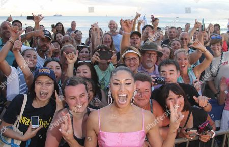 Meaghan Rath has fun with the fans during the Hawaii Five-O and Magnum P.I. Sunset On The Beach event on Waikiki Beach in Honolulu, Hawaii - Michael Sullivan/CSM