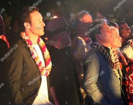 Alex O'Loughlin and Peter M. Lenkov enjoy the music of Train during the Hawaii Five-O and Magnum P.I. Sunset On The Beach event on Waikiki Beach in Honolulu, Hawaii - Michael Sullivan/CSM