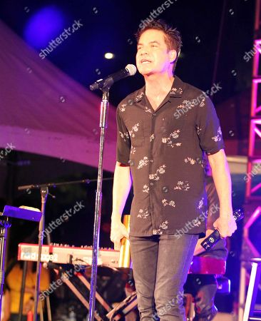 Lead Singer Patrick Monahan of Train performs during the Hawaii Five-O and Magnum P.I. Sunset On The Beach event on Waikiki Beach in Honolulu, Hawaii - Michael Sullivan/CSM