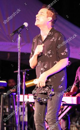 Stock Photo of Lead Singer Patrick Monahan of Train performs during the Hawaii Five-O and Magnum P.I. Sunset On The Beach event on Waikiki Beach in Honolulu, Hawaii - Michael Sullivan/CSM
