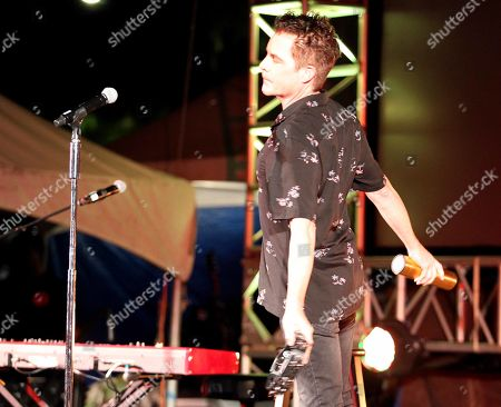 Stock Image of Lead Singer Patrick Monahan of Train performs during the Hawaii Five-O and Magnum P.I. Sunset On The Beach event on Waikiki Beach in Honolulu, Hawaii - Michael Sullivan/CSM
