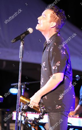 Stock Picture of Lead Singer Patrick Monahan of Train performs during the Hawaii Five-O and Magnum P.I. Sunset On The Beach event on Waikiki Beach in Honolulu, Hawaii - Michael Sullivan/CSM
