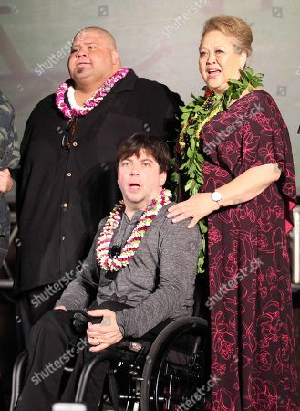 Looking like a family portrait, Shawn Mokuahi, Christopher Thornton and Amy Hill during the Hawaii Five-O and Magnum P.I. Sunset On The Beach event on Waikiki Beach in Honolulu, Hawaii - Michael Sullivan/CSM
