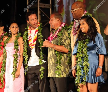 Stock Image of Meaghan Rath, Alex O'Loughlin, Dennis Chun, Chi McBride and Kimee Balmilero during the Hawaii Five-O and Magnum P.I. Sunset On The Beach event on Waikiki Beach in Honolulu, Hawaii - Michael Sullivan/CSM