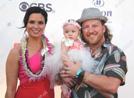 Katrina Law with her husband Keith Andreen and daughter Kinley during the Hawaii Five-O and Magnum P.I. Sunset On The Beach event on Waikiki Beach in Honolulu, Hawaii - Michael Sullivan/CSM