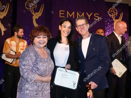 Patrika Darbo, Sian Clifford, Bob Bergen. Performer Peer Group Governors Patrika Darbo, left, and Bob Bergen, right, pose with Emmy nominee Sian Clifford, center, at the 2019 Performers Nominee Reception presented by the Television Academy at the Wallis Annenberg Center for the Performing Arts, in Beverly Hills, Calif