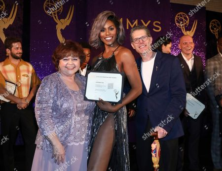 Patrika Darbo, Laverne Cox, Bob Bergen. Performer Peer Group Governors Patrika Darbo, left, and Bob Bergen, right, pose with Emmy nominee Laverne Cox, center, at the 2019 Performers Nominee Reception presented by the Television Academy at the Wallis Annenberg Center for the Performing Arts, in Beverly Hills, Calif