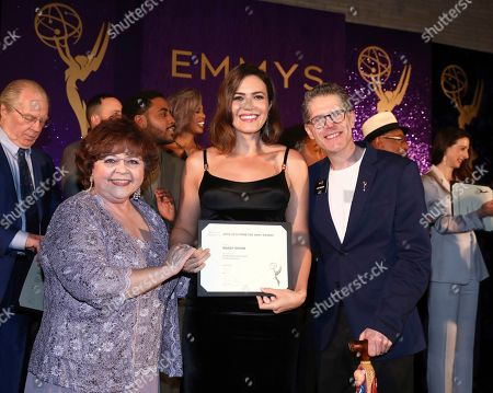 Patrika Darbo, Mandy Moore, Bob Bergen. Performer Peer Group Governors Patrika Darbo, left, and Bob Bergen, right, pose with Emmy nominee Mandy Moore, center, at the 2019 Performers Nominee Reception presented by the Television Academy at the Wallis Annenberg Center for the Performing Arts, in Beverly Hills, Calif