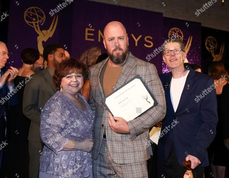Patrika Darbo, Chris Sullivan, Bob Bergen. Performer Peer Group Governors Patrika Darbo, left, and Bob Bergen, right, pose with Emmy nominee Chris Sullivan, center, a the 2019 Performers Nominee Reception presented by the Television Academy at the Wallis Annenberg Center for the Performing Arts, in Beverly Hills, Calif