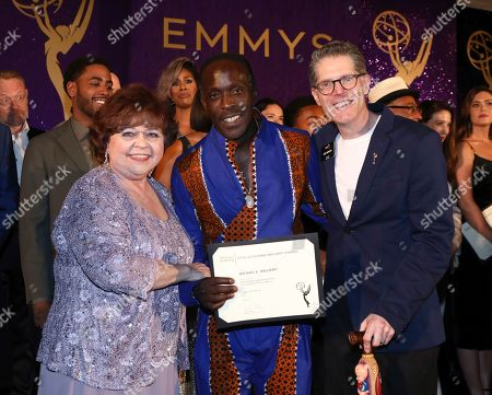 Patrika Darbo, Michael K. Williams, Bob Bergen. Performer Peer Group Governors Patrika Darbo, left, and Bob Bergen, right, pose with Emmy nominee Michael K. Williams, center, at the 2019 Performers Nominee Reception presented by the Television Academy at the Wallis Annenberg Center for the Performing Arts, in Beverly Hills, Calif
