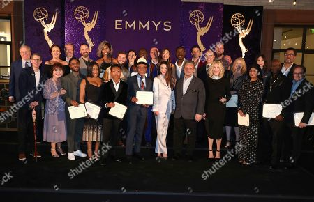 Bob Bergen, Patrika Darbo, Frank Scherma. Performer Peer Group Governors Bob Bergen, far left, Patrika Darbo, Television Academy Chairman and CEO Frank Scherma, center, pose with Emmy nominees for a group photo on stage at the 2019 Performers Nominee Reception presented by the Television Academy at the Wallis Annenberg Center for the Performing Arts, in Beverly Hills, Calif