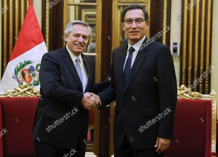 Martin Vizcarra, Alberto Fernandez. In this handout photo provided by the Peruvian Government Press Office, Peru's President Martin Vizcarra, right, shakes hands with Argentina's Presidential candidate Alberto Fernandez, during a photo opportunity at government palace in Lima, Peru