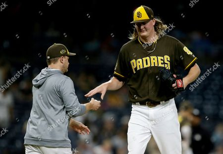 San Diego Padres relief pitcher Trey Wingenter, right, is removed by manager Andy Green during the eighth inning of the team's baseball game against the Arizona Diamondbacks in San Diego