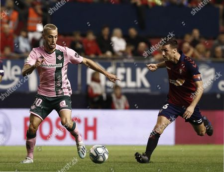 Oier Sanjurjo (R) of C.A Osasuna in action agianst Sergio Canales (L) of Real Betis during the LaLiga match between C.A Osasuna and Real Betis at El Sadar Stadium in Pamplona, Navarra, Spain, 20 September 2019.