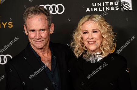 Catherine O'Hara, Bo Welch. Actress Catherine O'Hara poses with Bo Welch at the Performers Nominee Reception for Sunday's 71st Primetime Emmy Awards, in Beverly Hills, Calif