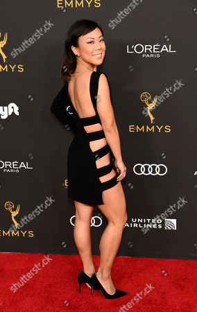 Ali Ahn poses at the Performers Nominee Reception for Sunday's 71st Primetime Emmy Awards, in Beverly Hills, Calif