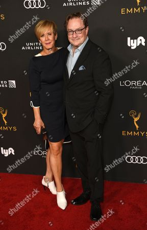 Stephen Root, Romy Rosemont. Actor Stephen Root poses with his wife Romy Rosemont at the Performers Nominee Reception for Sunday's 71st Primetime Emmy Awards, in Beverly Hills, Calif