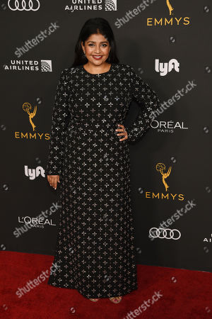 Punam Patel poses at the Performers Nominee Reception for Sunday's 71st Primetime Emmy Awards, in Beverly Hills, Calif