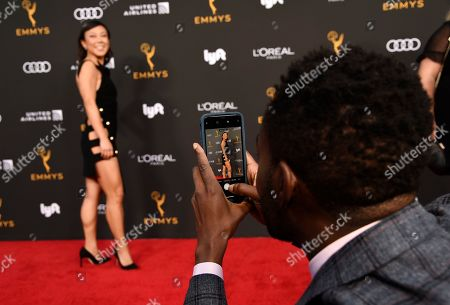William Jackson Harper, Ali Ahn. Actor William Jackson Harper, right, shoots a picture of his date, actress Ali Ahn, on the red carpet at the Performers Nominee Reception for Sunday's 71st Primetime Emmy Awards, in Beverly Hills, Calif
