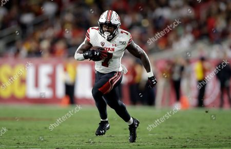 Utah running back Devonta'e Henry-Cole (7) runs against Southern California during the second half of an NCAA college football game, in Los Angeles
